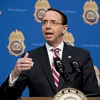 In this January 31, 2019, file photo, Deputy Attorney General Rod Rosenstein, speaks before welcoming Vice President Mike Pence to speak to Drug Enforcement Administration employees at their headquarters in Arlington, Virginia. (AP Photo/Andrew Harnik, File)