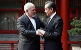 Iranian Foreign Minister Mohammad Javad Zarif, left, and his Chinese counterpart, Wang Yi, shake hands during their meeting at the Diaoyutai State Guesthouse in Beijing, February 19, 2019. (How Hwee Young/Pool Photo via AP)