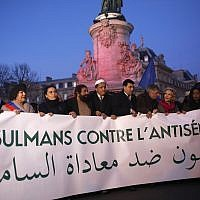 French Muslim people gather at the Republique square to protest against anti-Semitism in Paris, France, Feb. 19, 2019.  (AP Photo/Thibault Camus)