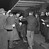 A crowd of demonstrators outside New York's Madison Square Garden as they seize a uniformed member of the German American Bund who had emerged from a Bund rally and attempted to enter a taxi, February 20, 1939. (AP Photo, File)