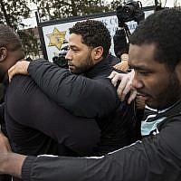 'Empire' actor Jussie Smollett, center, leaves Cook County jail following his release, Thursday, Feb. 21, 2019, in Chicago. (Ashlee Rezin/Chicago Sun-Times via AP)