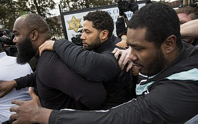 'Empire' actor Jussie Smollett, center, leaves Cook County jail following his release, Thursday, February 21, 2019, in Chicago. (Ashlee Rezin/Chicago Sun-Times via AP)