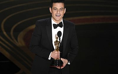 "Rami Malek accepts the award for best performance by an actor in a leading role for ""Bohemian Rhapsody"" at the Oscars on February 24, 2019, at the Dolby Theatre in Los Angeles. (Photo by Chris Pizzello/Invision/AP)"