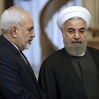 Iranian President Hassan Rouhani, right, listens to his Foreign Minister Mohammad Javad Zarif prior to a meeting in Tehran, Iran, November 24, 2015. (Vahid Salemi/AP)
