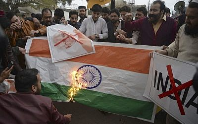Pakistani protesters burn a representation of an Indian flag during an anti-Indian rally in Peshawar, Pakistan, Tuesday, Feb. 26, 2019 following an Indian airstrike on Pakistan territory. (AP/Muhammad Sajjad)