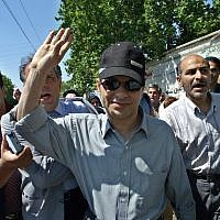 One of Iran's most prominent dissident journalist's, Akbar Ganji,  who was jailed in 2000 after his probe of the murders of five dissidents by Intelligence Ministry agents, waves, as he enters the Evin prison after a temporary release for medical reasons, in Tehran, Iran, June 11, 2005.  (AP/Vahid Salemi/File)