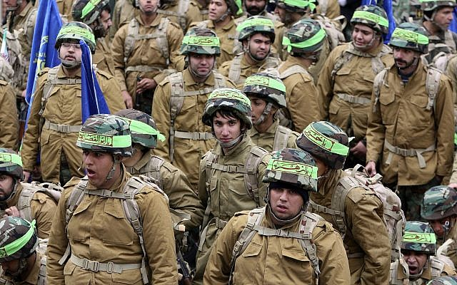 Illustrative: Members of the Iranian paramilitary Basij force, affiliated with the Revolutionary Guard, attend a rally in front of the former US Embassy in Tehran, Iran, on November 25, 2011. (AP Photo/Vahid Salemi)