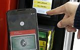 In this May 28, 2015, file photo, a Google employee gives a demonstration of Android Pay on a phone at Google I/O 2015 in San Francisco (AP Photo/Jeff Chiu, File)