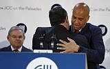 Then New Jersey Gov. Chris Christie, center, is hugged by US Sen. Cory Booker, right, after speaking to a crowd at the Kaplen Jewish Community Center on the Palisades during a rally against recent bomb threats made to Jewish centers, Friday, March 3, 2017, in Tenafly, N.J. Also seen is U.S. Sen. Bob Menendez, left, during the rally. (AP Photo/Julio Cortez)