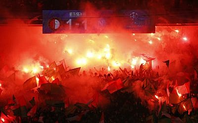 Illustrative: Feyenoord's fans light up flares during a Champions League Group F soccer match between Feyenoord and Napoli at the Kuip stadium in Rotterdam, Netherlands, on December 6, 2017. (AP Photo/Peter Dejong)