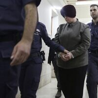 In this February 27, 2018, photo, Malka Leifer, center, is brought to a courtroom in Jerusalem. (AP Photo/Mahmoud Illean)