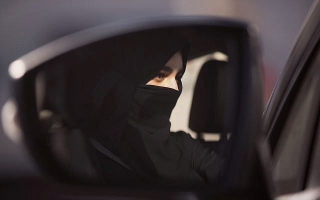 A student at the female-only campus of Effat University, sits for the first time in the driver's seat, during training sponsored by Ford Motor, in Jeddah, Saudi Arabia, Tuesday, March 6, 2018. (AP/Amr Nabil)