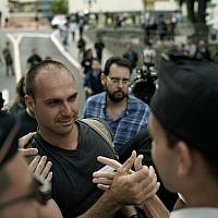 Eduardo Bolsonaro greets students as he leaves the Santa Casa hospital where his father was hospitalized in Juiz de Fora, Brazil, Sept. 6, 2018 (AP Photo/Leo Correa)