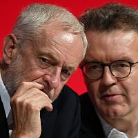 Britain's opposition Labour Party leader Jeremy Corbyn, left, talks with deputy leader Tom Watson, during the start of the party's annual conference in Liverpool, England, September 23, 2018. (Stefan Rousseau/PA via AP)