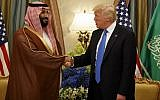 US President Donald Trump shakes hands with Saudi Crown Prince Mohammed bin Salman, in Riyadh, Saudi Arabia, on May 20, 2017. (AP Photo/Evan Vucci, File)