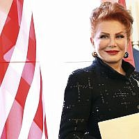 In this photo from September 6, 2018, Georgette Mosbacher stands next to an American flag after receiving her credentials as new United States ambassador to Poland in Warsaw. (AP Photo/Czarek Sokolowski, File)