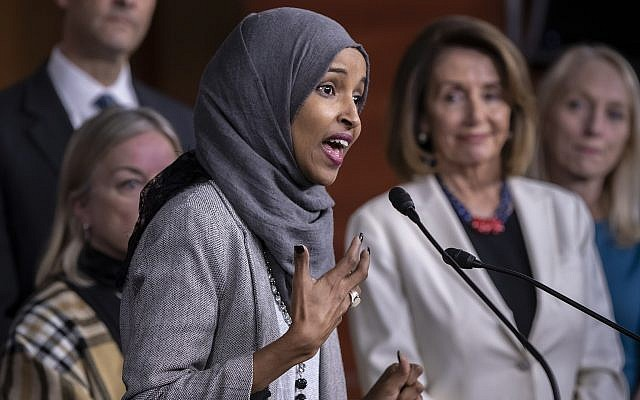 Then Rep.-elect Ilhan Omar, with then House Democratic Leader Nancy Pelosi of California, right, speaks about the party's legislative priorities during a news conference at the Capitol in Washington, November 30, 2018. (AP Photo/J. Scott Applewhite)