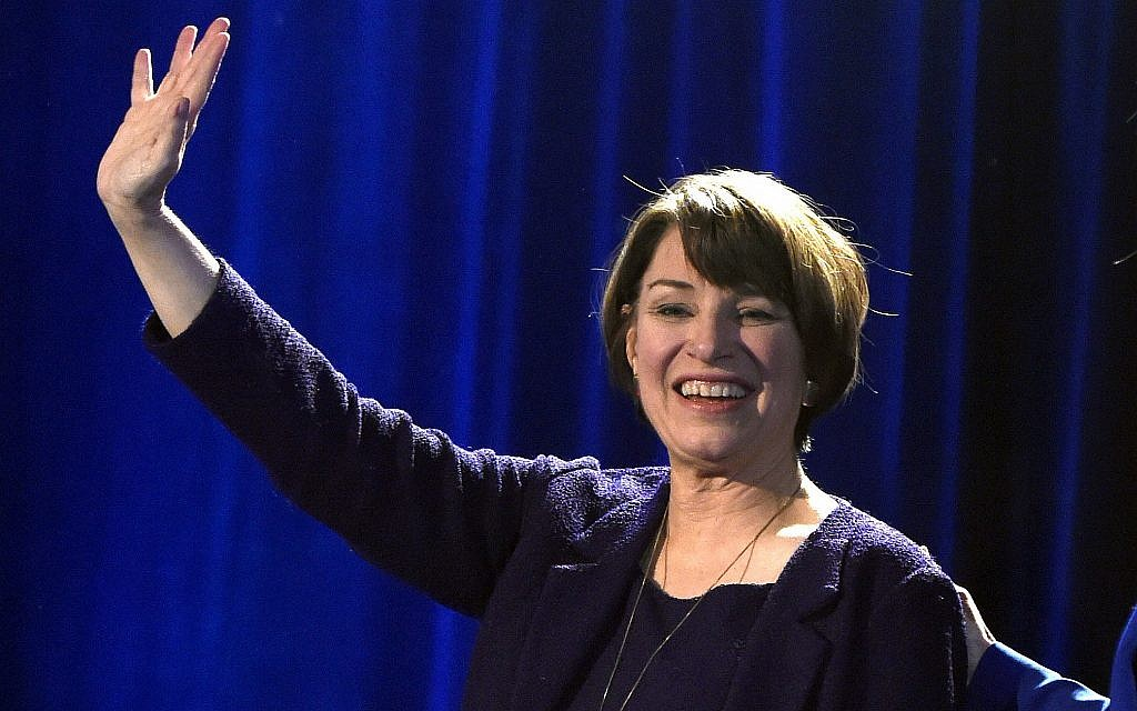 In this November 6, 2018, file photo, Sen. Amy Klobuchar waves to supporters after winning re-election during the Democratic election night party in St. Paul, Minnsota (AP Photo/Hannah Foslien