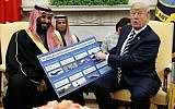 US President Donald Trump shows a chart highlighting arms sales to Saudi Arabia during a meeting with Saudi Crown Prince Mohammed bin Salman in the Oval Office of the White House in Washington on March 20, 2018. (AP Photo/Evan Vucci)