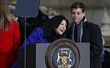 Democratic Attorney General Dana Nessel, laughs before addressing the crowd outside the state Capitol building, Tuesday, January 1, 2019 in Lansing, Michigan. (AP Photo/Carlos Osorio)