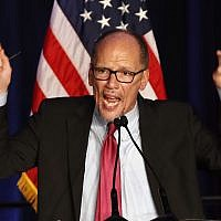 In this this Nov. 6, 2018, file photo, Tom Perez, Chairman of the Democratic National Committee, introduces Minority Leader Nancy Pelosi of Calif., as he speaks about Democratic wins in the House of Representatives to a crowd of Democratic supporters in Washington.(AP Photo/Jacquelyn Martin)