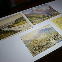 Three watercolor landscapes, allegedly painted by a young Adolf Hitler, are displayed at an auction house in Berlin, Germany, January 24, 2019. (Gregor Fischer/dpa via AP)