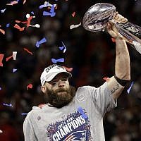 New England Patriots' Julian Edelman (#11) holds the Vince Lombardi Trophy after the NFL Super Bowl 53 football game against the Los Angeles Rams, Feb.ruary 3, 2019, in Atlanta. The Patriots won 13-3. Edelman was named the Most Valuable Player. (AP Photo/Mark Humphrey)