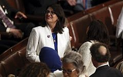 Rep. Rashida Tlaib, Democrat-Michigan, stands on the floor before US President Donald Trump delivers his State of the Union address on Capitol Hill in Washington, February 5, 2019. (Andrew Harnik/AP)