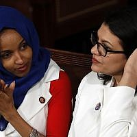 Rep. Ilhan Omar, D-Minn., left, and Rep. Rashida Tlaib, D-Mich., right, listen as US President Donald Trump delivers his State of the Union address to a joint session of Congress on Capitol Hill in Washington, February 5, 2019. (AP Photo/J. Scott Applewhite)