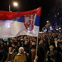 In this file photo dated Feb. 2, 2019, people march during a protest against populist President Aleksandar Vucic in Belgrade, Serbia (AP Photo/Darko Vojinovic, FILE)