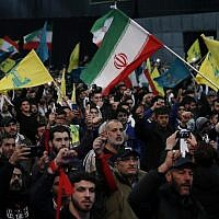 Hezbollah supporters shout slogans and wave Lebanese, Hezbollah and Iran flags, during a rally to commemorate the 40th anniversary of Iran's Islamic Revolution, in southern Beirut, Lebanon, on February 6, 2019. (AP Photo/Hussein Malla)
