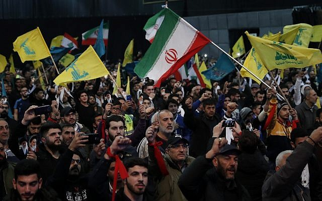 Illustrative: Hezbollah supporters shout slogans and wave Lebanese, Hezbollah and Iran flags, during a rally to commemorate the 40th anniversary of Iran's Islamic Revolution, in southern Beirut, Lebanon, on February 6, 2019. (AP Photo/Hussein Malla)