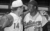 In this April 1, 1966, file photo, Cincinnati Reds' Pete Rose, left, greets Baltimore Orioles' Frank Robinson before a spring training baseball game, in Tampa, Fla. (AP/Paul Shane)