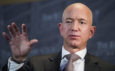 In this Sept. 13, 2018, file photo Jeff Bezos, Amazon founder and CEO, speaks at The Economic Club of Washington's Milestone Celebration in Washington. Bezos says the National Enquirer is threatening to publish nude photographs of him unless his private investigators back off the tabloid that detailed the billionaire's extramarital affair (AP Photo/Cliff Owen,)