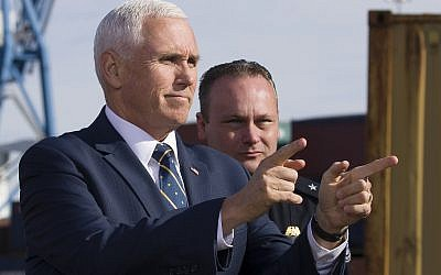 US Vice President Mike Pence points to the crowd of agents before speaking after a tour of Customs and Border Protection operations at the Port of Baltimore, February 8, 2019, in Baltimore. (AP Photo/Alex Brandon)