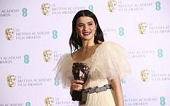 Actress Rachel Weisz poses for photographers backstage with her Best Supporting Actress award for her role in the film 'The Favourite' at the BAFTA awards in London, February 10, 2019. (Photo by Joel C Ryan/Invision/AP)
