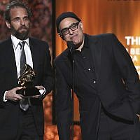 Dean Sharenow, left, and David Yazbek accept the award for best musical theater album for 'The Band's Visit' at the 61st annual Grammy Awards on Sunday, February 10, 2019, in Los Angeles. (Matt Sayles/Invision/AP)