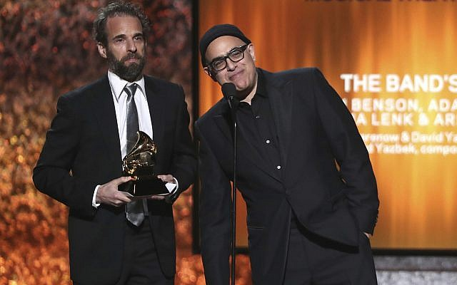 """Dean Sharenow, left, and David Yazbek accept the award for best musical theater album for """"The Band's Visit"""" at the 61st annual Grammy Awards on Sunday, Feb. 10, 2019, in Los Angeles. (Photo by Matt Sayles/Invision/AP)"""