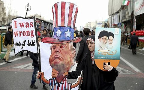 An Iranian woman holds an effigy of US president Donald Trump, during a rally marking the 40th anniversary of the 1979 Islamic Revolution, in Tehran, Iran, February 11, 2019. (AP/Ebrahim Noroozi/File)