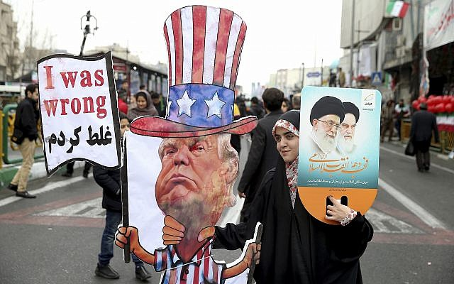 An Iranian woman holds an effigy of US president Donald Trump, during a rally marking the 40th anniversary of the 1979 Islamic Revolution, in Tehran, Iran, Monday, Feb. 11, 2019. (AP/Ebrahim Noroozi)