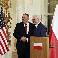 Polish Foreign Affairs Minister Jacek Czaputowicz,right, and US Secretary of State Mike Pompeo shake hands at a news conference at Lazienki Palace, Warsaw, Poland, February 12, 2019. (AP Photo/Czarek Sokolowski)