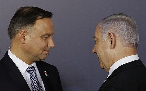 Polish President Andrzej Duda ,left, and Israeli Prime Minister Benjamin Netanyahu, right, talk after a group photo at the Royal Castle in Warsaw, February 13, 2019. (AP/Czarek Sokolowski)