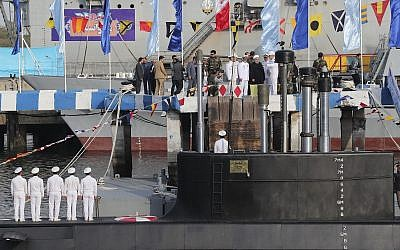 Iranian President Hassan Rouhani, center with white turban, and other dignitaries attend the inauguration of the new Iranian made 'Fateh' submarine in Bandar Abbas on February 17, 2019. (Iranian Presidency Office via AP)