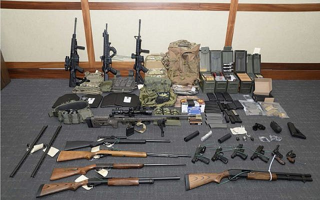"""This image provided by the U.S. District Court in Maryland shows a photo of firearms and ammunition that was in the motion for detention pending trial in the case against Christopher Paul Hasson. Prosecutors say that Hasson, a Coast Guard lieutenant is a """"domestic terrorist""""  (US District Court via AP)"""