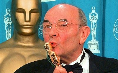 In this March 23, 1998 file photo, director Stanley Donen kisses the Oscar he received for Lifetime Achievement backstage at the 70th Academy Awards at the Shrine Auditorium in Los Angeles. (AP/Reed Saxon)