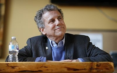 US Sen. Sherrod Brown, D-Ohio, waits before speaking at an event at a brewery Saturday, Feb. 23, 2019, in Henderson, Nev. (AP Photo/John Locher)