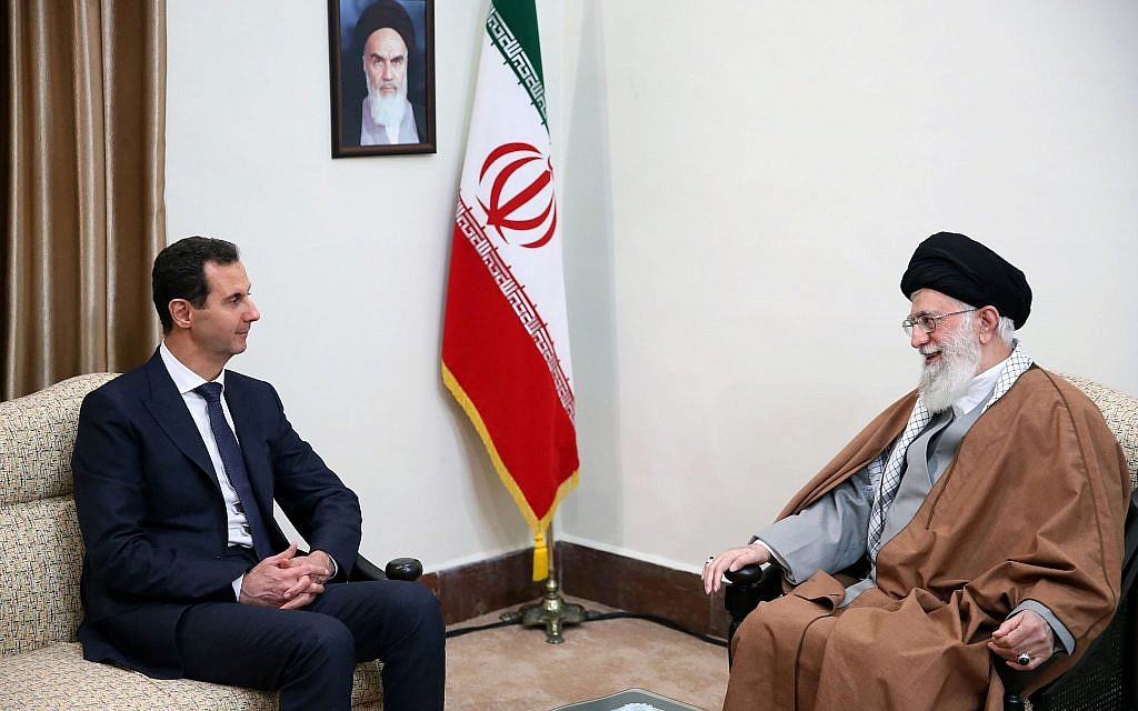 In this picture released by an official website of the office of the Iranian supreme leader, Supreme Leader Ayatollah Ali Khamenei, right, speaks with Syrian President Bashar Assad in Tehran, Iran, February 25, 2019. (Office of the Iranian Supreme Leader via AP)