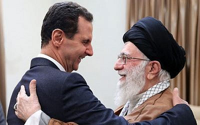In this photo released by the Syrian official news agency SANA, Syrian President Bashar Assad, left, shakes hands with Iranian Supreme Leader Ayatollah Ali Khamenei, before their meeting in Tehran, Iran, on February 25, 2019.  (SANA via AP)