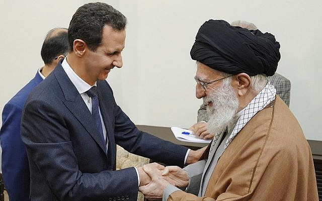 Syrian President Bashar Assad, left, shakes hands with Iranian Supreme Leader Ayatollah Ali Khamenei, before their meeting in Tehran, Syria, February 25, 2019. (Photo released by the Syrian official news agency, SANA, via AP)