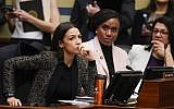 House Oversight and Reform Committee members, from left, Rep. Alexandria Ocasio-Cortez, D-N.Y., Rep. Ayanna Pressley, D-Mass., and Rep. Rashida Tlaib, D-Mich., listen during a committee hearing on Capitol Hill in Washington, February 26, 2019. (AP Photo/J. Scott Applewhite)